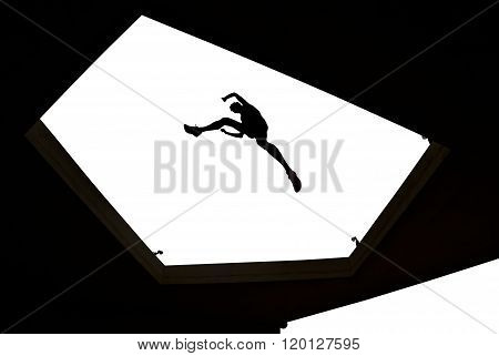 Man Jumping Over Building Roof On White Background