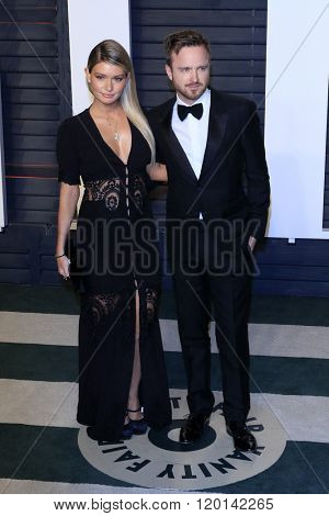 LOS ANGELES - FEB 28:  Aaron Paul, Lauren Parsekian at the 2016 Vanity Fair Oscar Party at the Wallis Annenberg Center for the Performing Arts on February 28, 2016 in Beverly Hills, CA