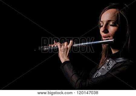A Young Girl Playing The Flute