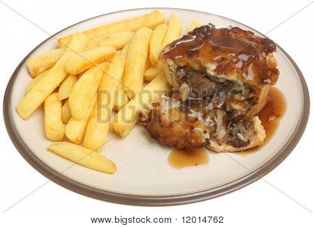 Steak pie with chips and gravy.