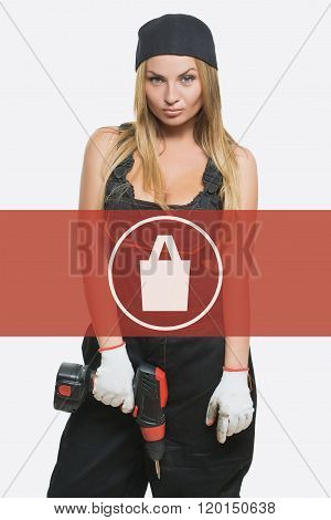 sexy female holding a cordless screwdriver. Repair icon in the background woman. purchases