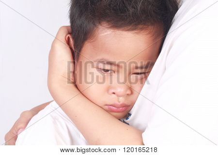 Sad Asian Boy, Crying In His Mothers Arm