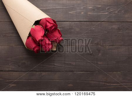 Red Roses Flower Are On The Wooden Background