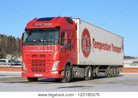 Red Volvo FH Semi Truck And Blue Sky
