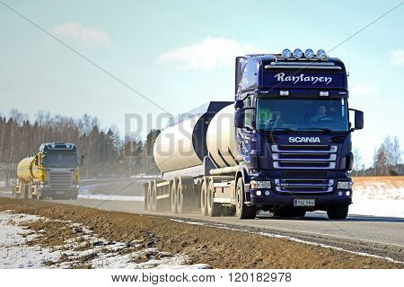 Two Scania Tank Trucks Platoon Along Spring Highway