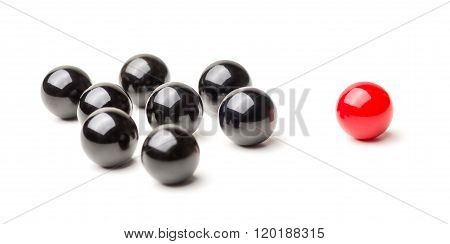 Concept With Red And Black Marbles -  Mobbing