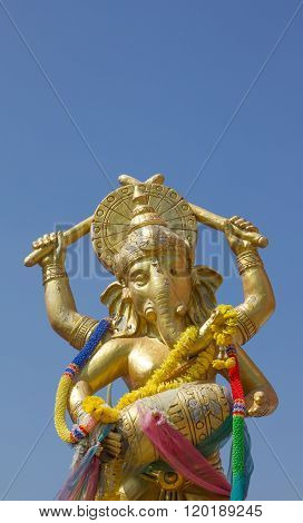 gold color Ganesha play song with blue sky blackground