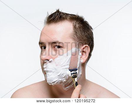 Man Shaves Shaving Foam