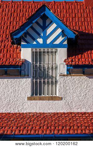A window of the Victoria Queen District in Huelva