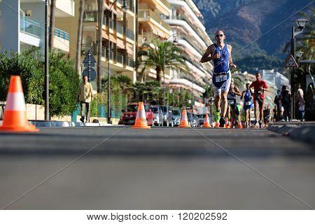 Runner Ahead In Blue Suit