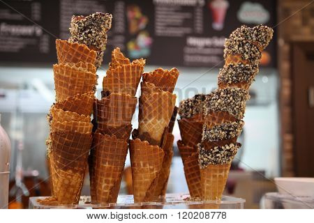 Waffle Cones With Chocolate And Nuts For Ice-cream On The Counter