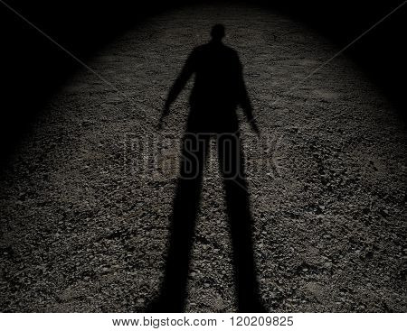 Shadow of a man on the ground texture.
