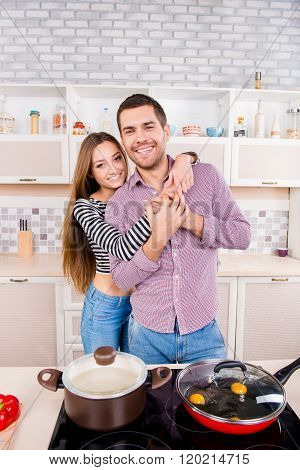 Cute Couple In Love Making Omlet And Boiling Soup In The Kitchen