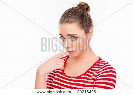 Portrait Of Upset Cute Dumpish Girl Touching Her Lips