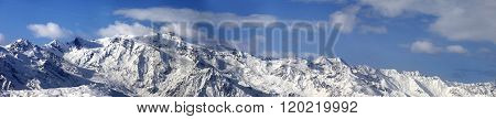 Large Panoramic View On Snowy Mountains In Nice Sunny Day
