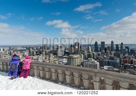 Two Kids Looking At Montreal Skyline