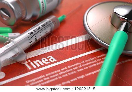 Tinea - Printed Diagnosis on Orange Background.