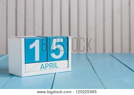April 15th. Tax Day. Image of april 15 wooden color calendar on white background.  Spring day, empty