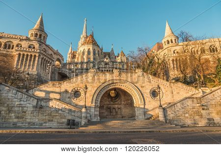 Sunlit Fisherman's Bastion in Budapest Hungary at Sunrise. View from below. poster