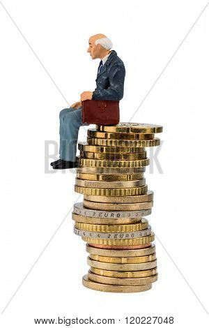 pensioners sitting on a pile of money