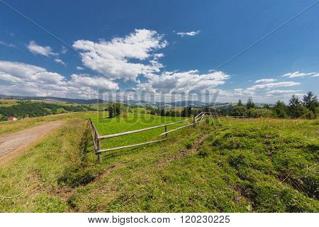 Wooden Fence On Mountain Backgrond