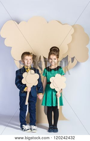 Love concept. Couple of kids. boy and girl with  cardboard flowers