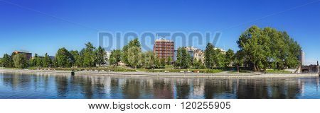 TAMPERE FINLAND - JUNE 2012: Panorama of Tampere river with hotels and office buildings in the background on June 16 2012 in Tampere Finland.