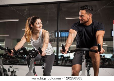 Cute Young Couple Flirting At A Gym