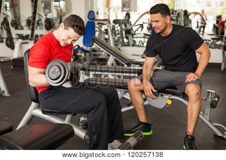 Man Encouraging His Friend At The Gym
