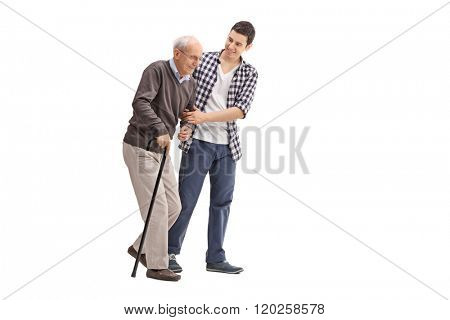 Young man helping a senior gentleman with a cane isolated on white background poster