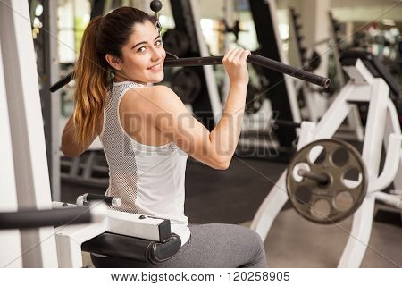 Pretty Strong Brunette Working Out In A Gym