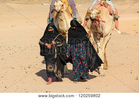 HURGHADA, EGYPT - Apr 24 2015: The old and young women-cameleers from Bedouin village in Sahara dese