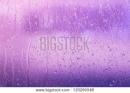 Rain On A Window In Purple Colors