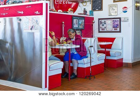 Gallup, U.S.A. - May 23, 2011: New Mexico, an elderly couple in a vintage style restaurant on the Route 66.