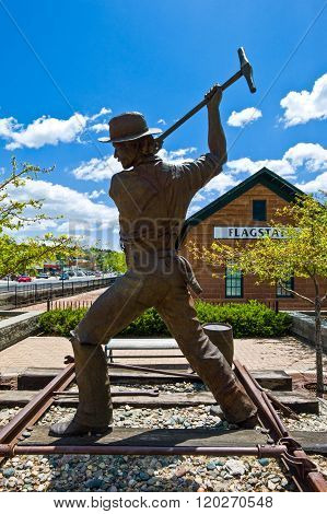 Flagstaff, U.S.A. - May 24, 2011: Arizona, the monument to the worker of the railway station.