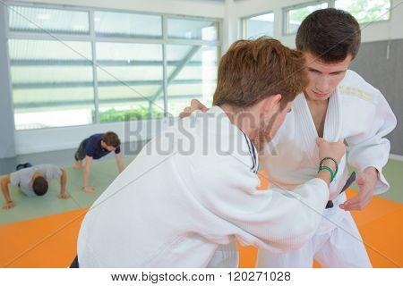 Two men in martial arts combat