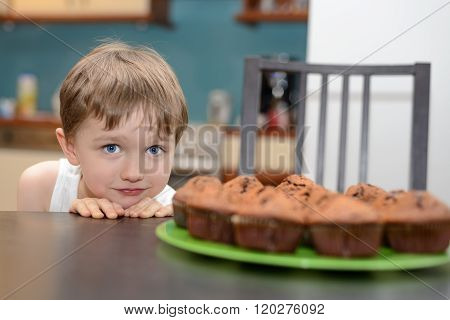 4 Year Old Boy Hungrily Looking At Chocolate Cake