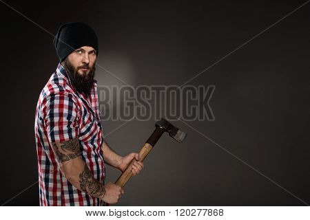 Serious Bearded Woodcutter Holding An Axe
