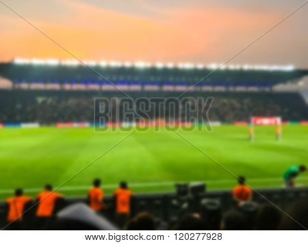 Blurry de-focused on stadium football twilight background.
