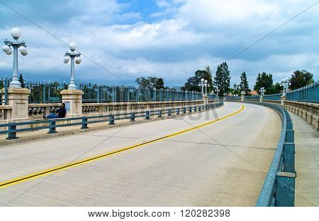 Pasadena, U.S.A. - May 28, 2011: California, Route 66, a man sitting in the Colorado bridge.