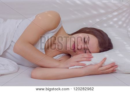 Sleeping woman young beautiful caucasian female sleep in the bed.