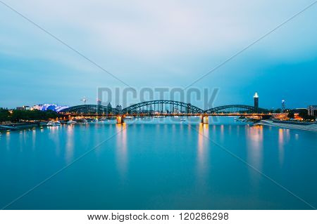 Night View Of Hohenzollern Arch Bridge Over River Rhine, Germany