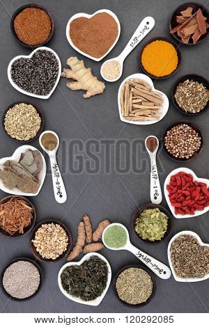Health background border of herb and spice selection used in natural alternative herbal medicine for men over slate background.