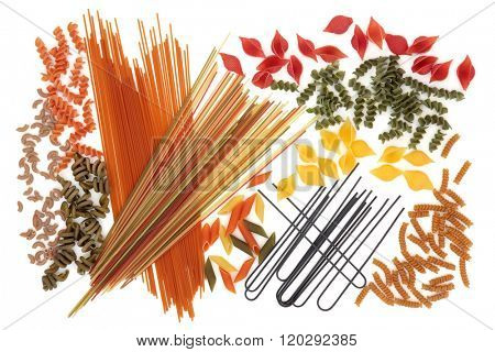 Dried coloured spaghetti pasta food selection forming an abstract background over white. Colouring obtained by using quid ink, spinach, tomato, carrot and beetroot vegetables.