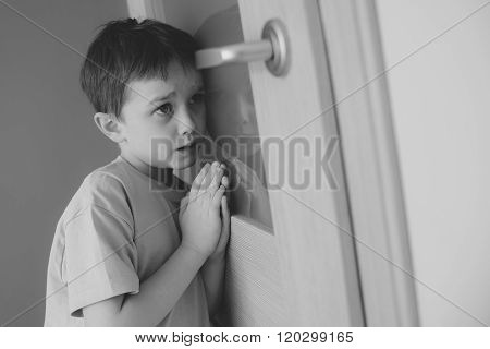 Little Sad Boy Overhears Fight Of His Parents - B&w
