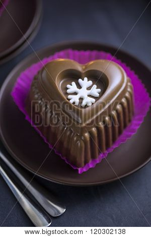 Chocolate Heart Cake with White Snowflake for New Year's Eve