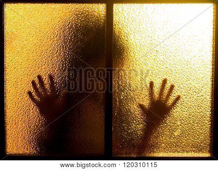 Silhouette behind a door