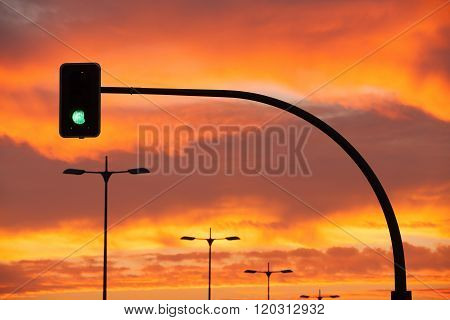 Green Traffic Light In A Dramatic Sunset