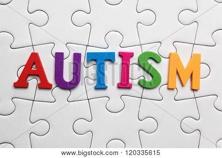Autism inscription on a white puzzle background