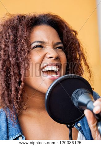 Woman With Frizzy Hair Singing While Looking Away